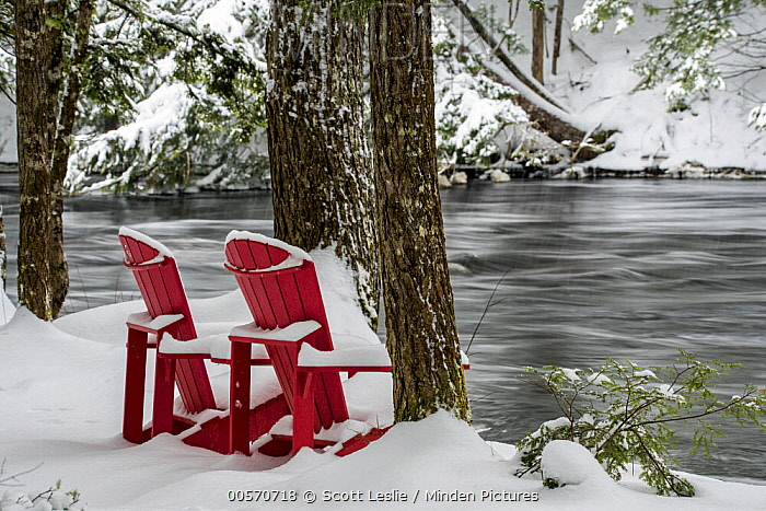 Adirondack chairs along river in winter, Mersey River, Kejimkujik National Park, Nova Scotia, Canada