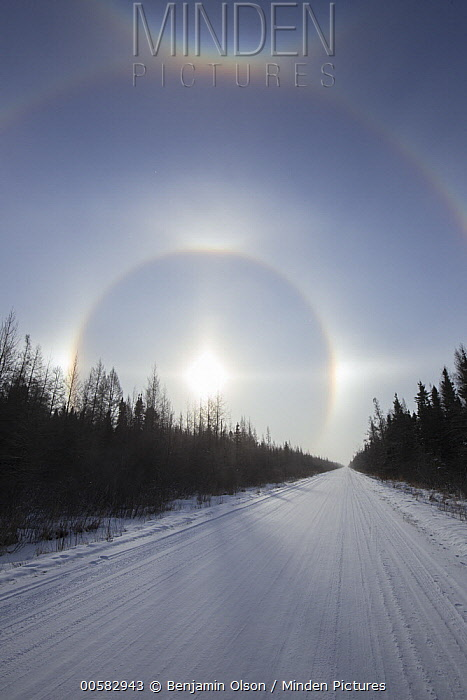 Sundogs over road in winter, Sax-Zim Bog, Minnesota
