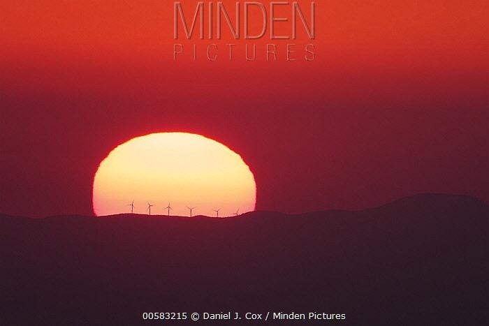 Windmills on ridge at sunset, France