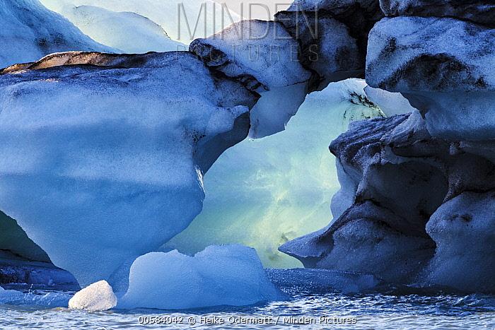Ice in glacial lagoon, with black volcanic dust, Jokulsarlon Lake, Skaftafell National Park, Iceland