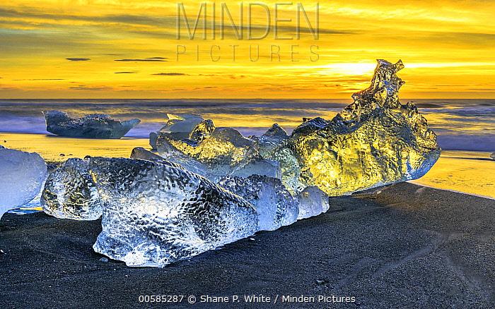 Ice washed ashore on beach at sunrise, Jokulsarlon Lagoon, Iceland