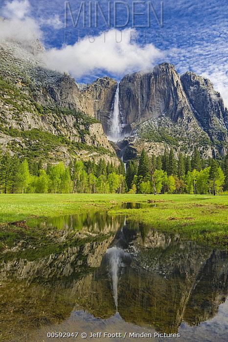 Waterfall reflected in flooded meadow, Yosemite Falls, Yosemite National Park, California