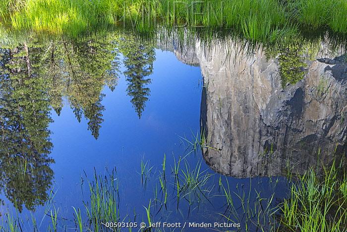 Granite cliff reflected in river, El Capitan and Merced River, Yosemite National Park, California