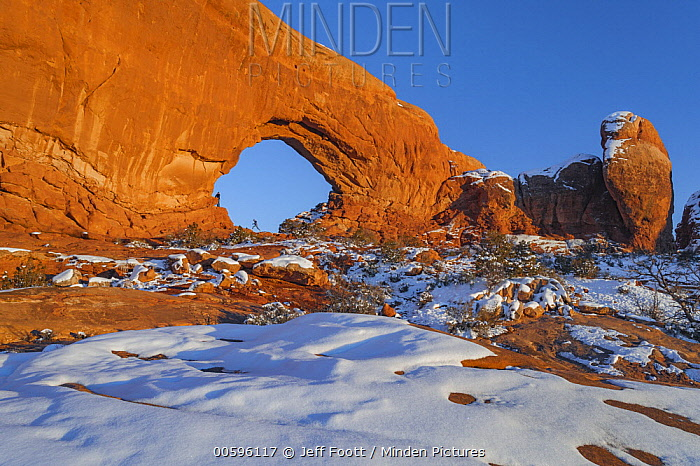 North Window sandstone arch with tourist, Arches National Park, Utah