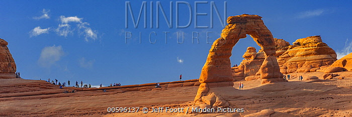 Tourists overcrowding at Delicate Arch, Arches National Park, Utah