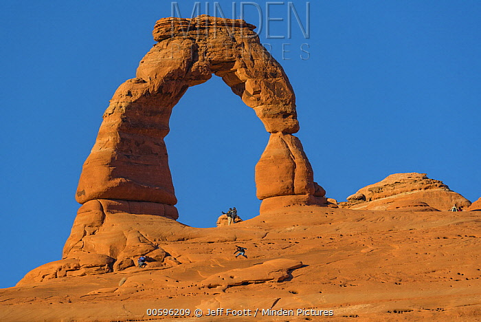 Tourists and Delicate Arch, Arches National Park, Utah