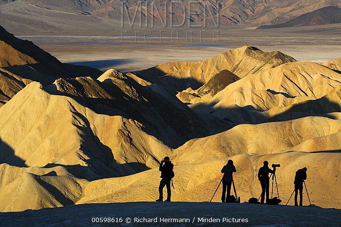 Photographers in desert, Zabriskie Point, Death Valley National Park, California