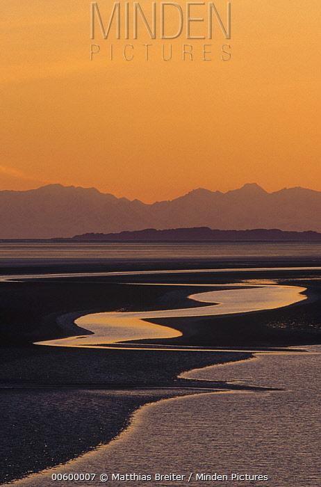 Tidal flats in Turnagain Arm at sunset, Alaska Range, Lake Clark National Park and Preserve, Alaska  -  Matthias Breiter
