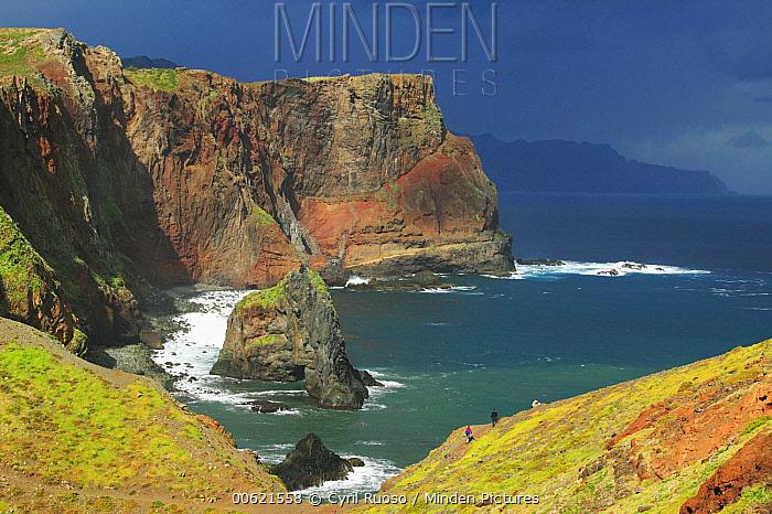 Tourists walking along rocky cliffs in the Ponta de Sao Lourenco Nature Reserve, Madeira  -  Cyril Ruoso