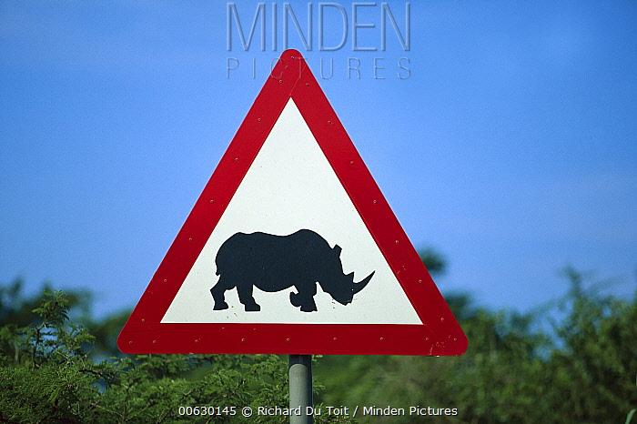 Rhinoceros (Diceros sp) warning sign along side of the road, Phinda Game Reserve, South Africa  -  Richard Du Toit