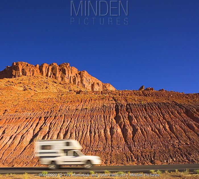 Car driving throug badlands, Glen Canyon National Recreation Area, Utah