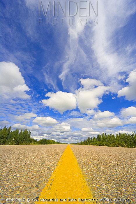Road and cumulus clouds, Alaska Highway, British Columbia, Canada