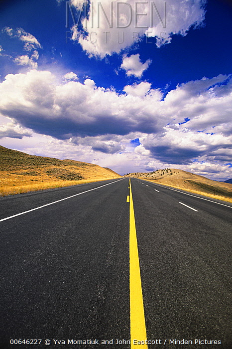 Highway and cumulus clouds, Wyoming