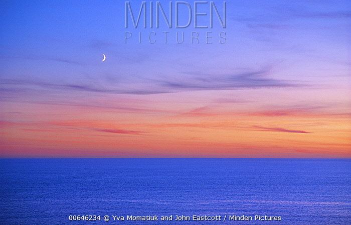Moon at sunset over ocean, Newfoundland, Canada