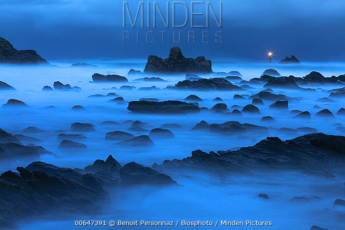 Rocky shore and Porspoder lighthouse at night, Bretagne, France