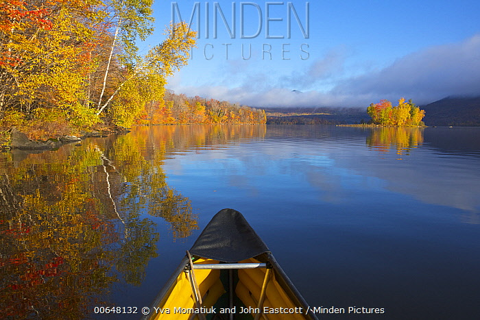 Deciduous forest, canoe, and reservoir in autumn, Chittenden Reservoir, Vermont