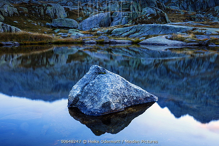 Rock in lake, Gotthard Pass, Alps, Switzerland