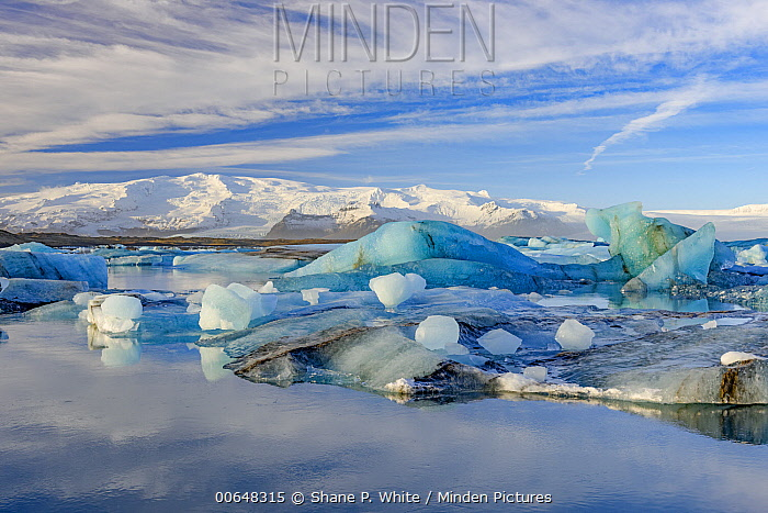 Iceberg and coastal mountains, Jokulsarlon, Iceland