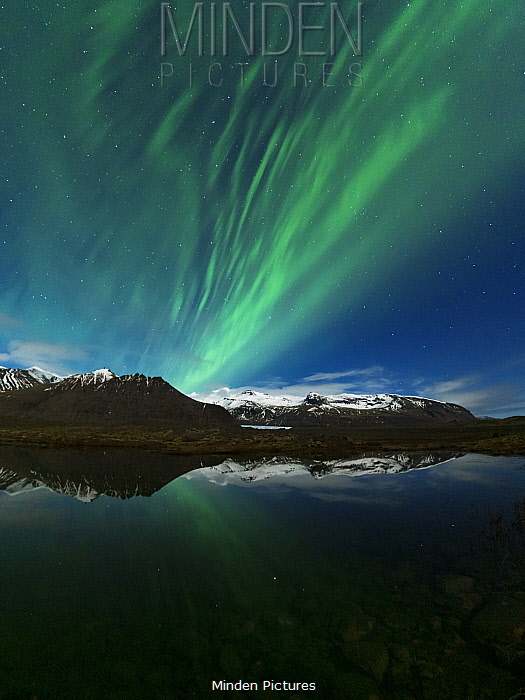 Northern lights over coastal mountains, southern Iceland