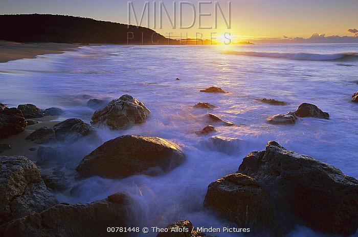 Rocky seashore at sunrise, Mimosa Rocks National Park, Australia  -  Theo Allofs