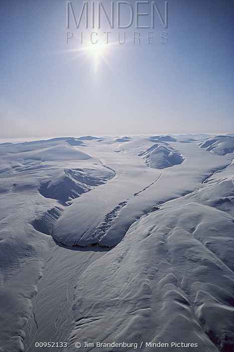 Aerial view of glacier and snow covered mountains, Ellesmere Island, Nunavut, Canada  -  Jim Brandenburg