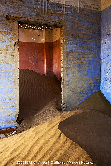 Sand-filled rooms in an abandoned house, Kolmanskop, Luderitz, Namibia  -  Vincent Grafhorst