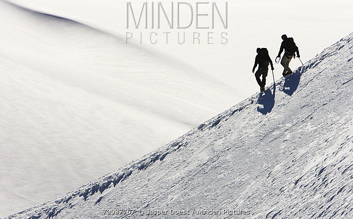 Alpinists hiking over snow  -  Jasper Doest