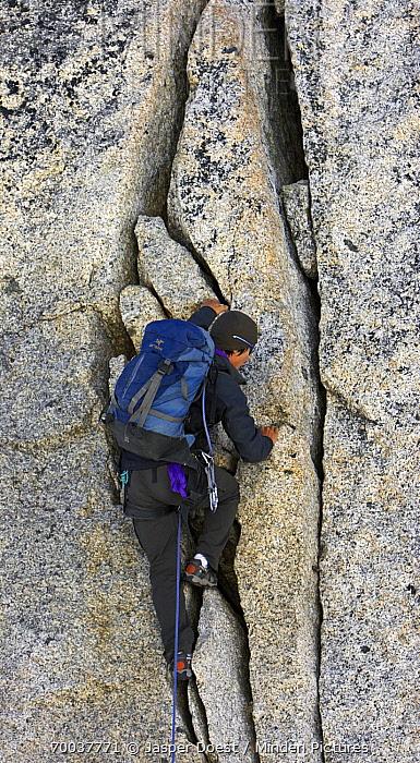Mountaineer climbing rock face  -  Jasper Doest