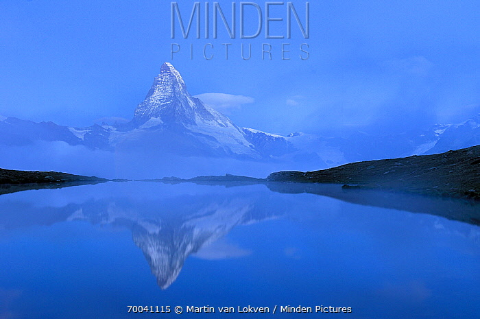 Matterhorn reflected in Stellisee at sunrise, Matterhorn, Pennine Alps, Valais, Switzerland  -  Martin van Lokven