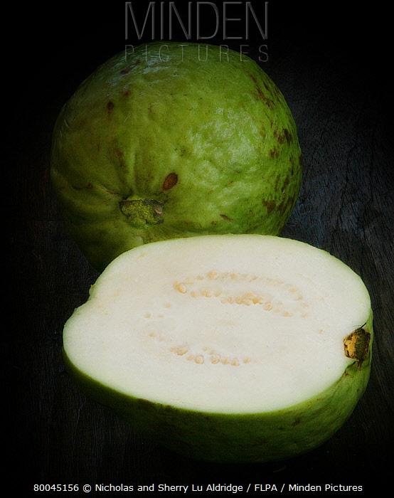 Guava (Psidium sp) edible fruit, whole and halved  -  Nicholas and Sherry Lu Aldridge/