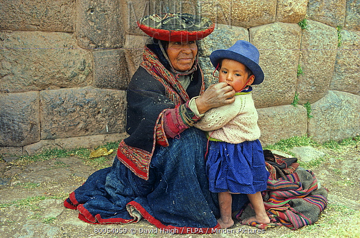 Woman and child, beside ancient Inca wall, Chincheros, Peru  -  David Haigh/ FLPA