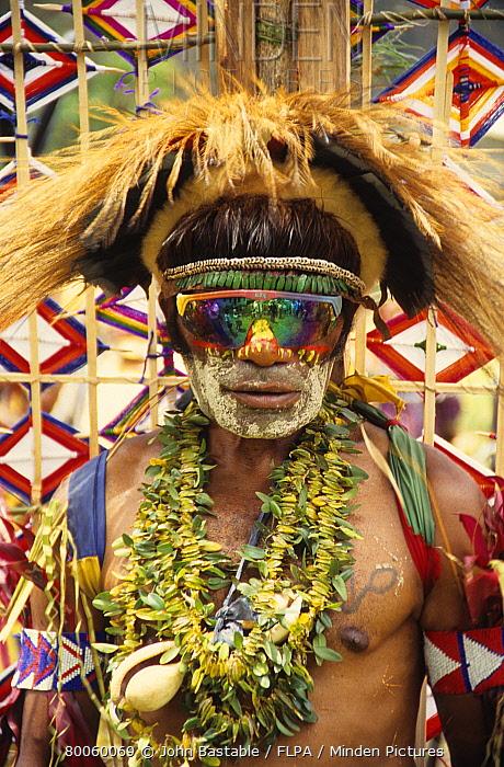 Man in traditional tribal dress, modern sunglasses, Goroka Show sing-sing, Goroka, Eastern Highlands Province, Papua New Guinea  -  John Bastable/ FLPA