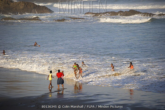 Local people playing in surf, Second Beach, Port St. Johns, 'Wild Coast', Eastern Cape (Transkei), South Africa  -  Colin Marshall/ FLPA