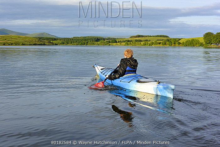 Boy kayaking on reservoir, Killington Lake, Killington Beck, Cumbria, England, June  -  Wayne Hutchinson/ FLPA