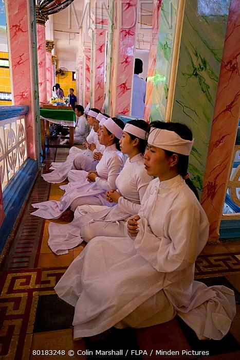 Caodaist disciples sitting on balcony during ceremony, Cao Dai temple, Tay Ninh Holy See, Tay Ninh, Tay Ninh Province, Vietnam, December  -  Colin Marshall/ FLPA