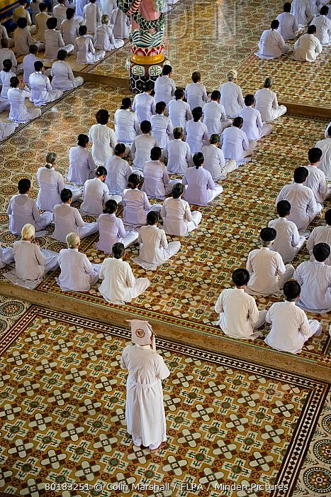 Caodaist disciples sitting during ceremony, Cao Dai temple, Tay Ninh Holy See, Tay Ninh, Tay Ninh Province, Vietnam, December  -  Colin Marshall/ FLPA