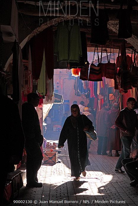 Woman walking into the shade of the Souk of Marrakech market, Morocco December 2007  -  Juan Manuel Borrero/ npl