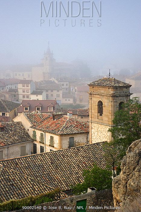 View over the rooftops of Niebla town on a foggy day, Molina de Aragon, Guadalajara, Spain  -  Jose B. Ruiz/ npl