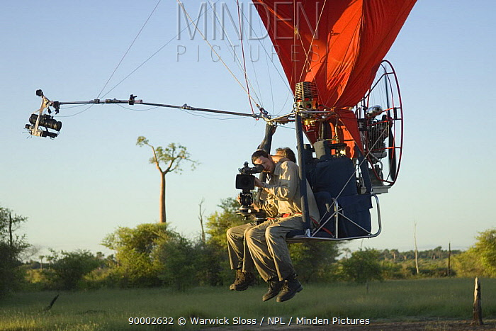 Cameraman Warwick Sloss in specially adapted hot air balloon, preparing to film Baobab trees in Morondava, Western Madagascar for BBC series Planet Earth 'Forests'  -  Warwick Sloss/ npl