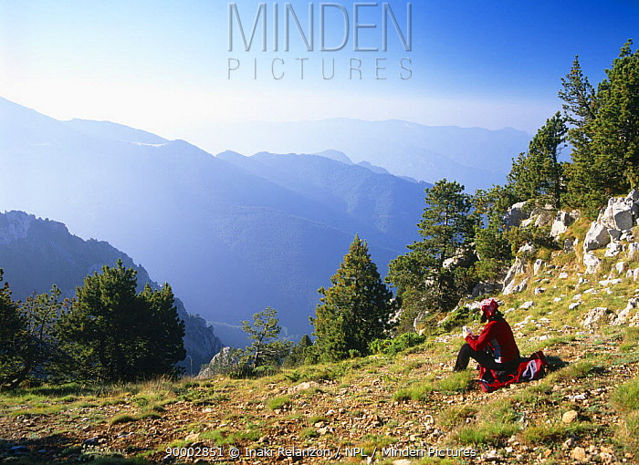 A Hiker resting and admiring the view in Cadi Moixero Natural Park, Spanish Pyrenees  -  Inaki Relanzon/ npl