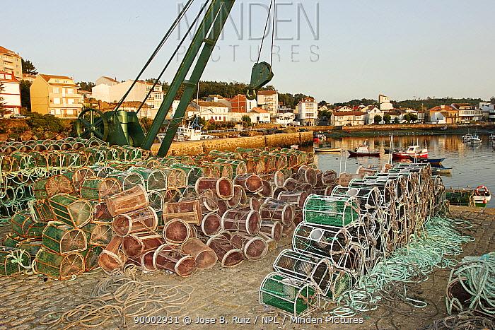 Lobster, crab pots and crane on the harbourside, Costa da Morte, Galicia, Spain  -  Jose B. Ruiz/ npl