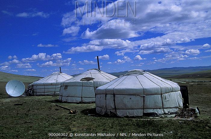 Satellite dish outside traditional gers, yurts, Gobi desert, Mongolia, central Asia  -  Konstantin Mikhailov/ npl