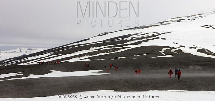 Tourists crossing the mountains that rim the volcanic caldera of Deception Island, South Shetland Islands, Antarctic Peninsula, Antarctica December 2007  -  Adam Burton/ npl