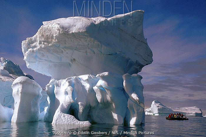Tourists in Zodiak boat view interesting shaped icebergs, Antarctica 2008  -  Edwin Giesbers/ npl