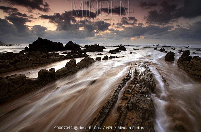 Waves rushing over rocks on Barrika Beach, Bilbao, Basque Country, Spain  -  Jose B. Ruiz/ npl
