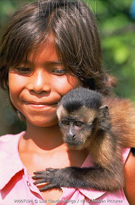 Girl with pet Tufted capuchin monkey (Cebus apella apella) Amazonas, Brazil  -  Luiz Claudio Marigo/ npl