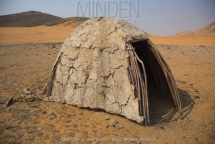 Mud and dung hut of Himba tribe, Kaokoland, Namibia 2007  -  Sue Flood/ npl