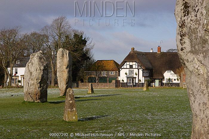 Avebury Stone Circle (World Heritage Site) with pub and other village buildings, Avebury, Wiltshire, UK  -  Michael Hutchinson/ npl