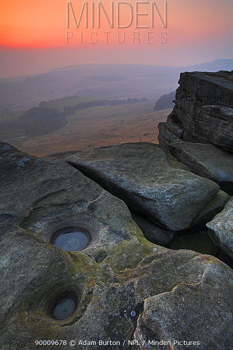 Foggy sunset on Stanage Edge in the Peak District National Park, Derbyshire, England  -  Adam Burton/ npl