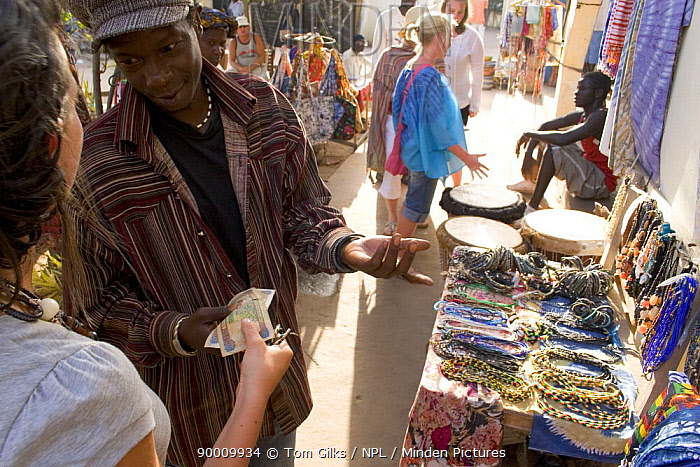 Tourists shopping at Senegambia craft market, Gambia, 2007  -  Tom Gilks/ npl
